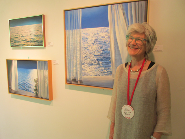 Alice Dalton Brown with her paintings