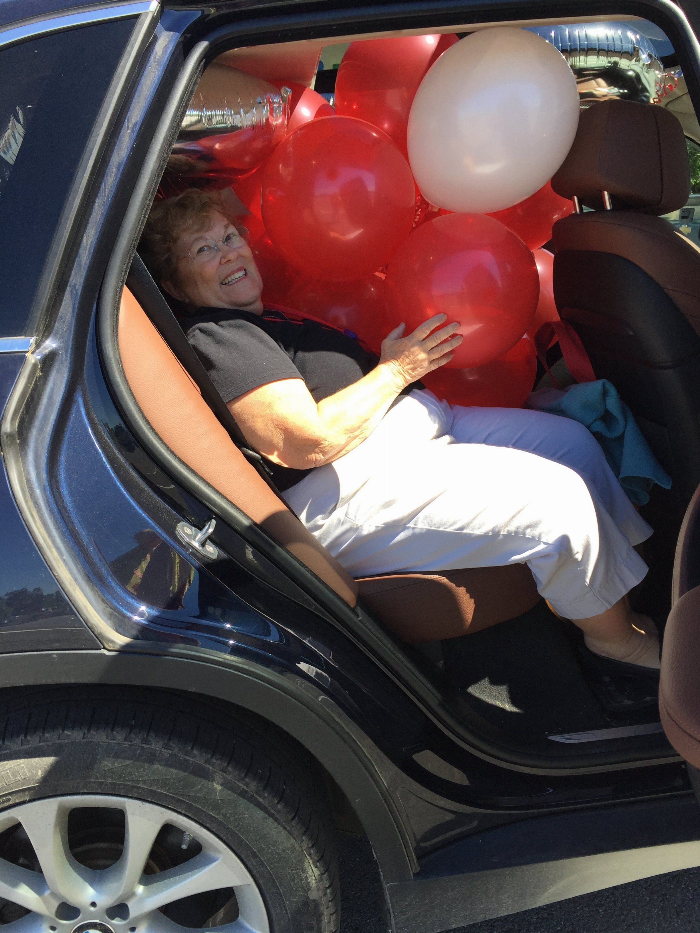 Cathy Van Buren Bomberger with Class of '62 airbag aka decorations for reunion headquarters!