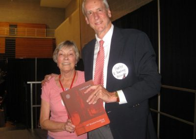 Ruth Bleyler presenting Hunter Rawlers with Reunion Yearbook