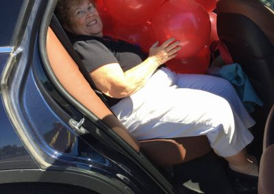 Cathy Van Buren Bomberger with Class of 62 airbag aka balloon decorations for reunion headquarters