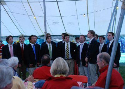 Mens chorus at picnic luncheon