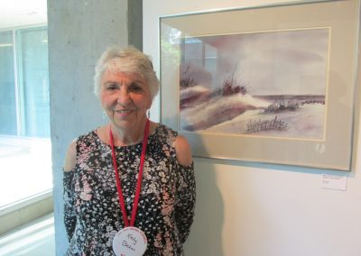 Classmate and 3-time Reunion chairperson Kelley Behan with her paintings