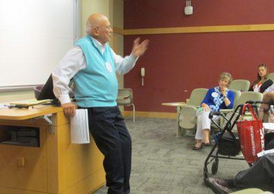 Ken-Blanchard speaking in Statler Hall with Margie listening