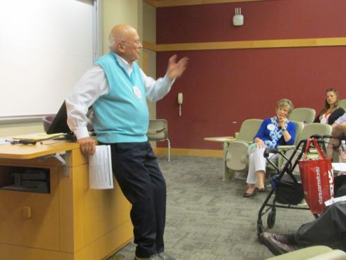 Ken Blanchard speaking in Statler Hall with Margie listening.